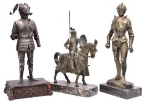 """A silvered spelter figure of a standing knight in 16th century style full armour, the base marked """""""