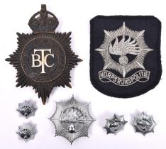 A pre 1952 British Transport Commission Police helmet plate; also a pre 1993 Netherlands National
