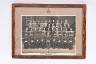 """A framed group photograph of the graduating class at the """"Metropolitan Police Training School,"""