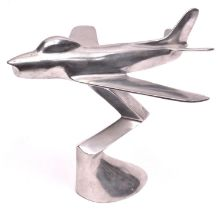 """An F86 sabre jet aircraft desk model, made of stainless steel, 9"""" high, 10"""" long. GC £10-20"""