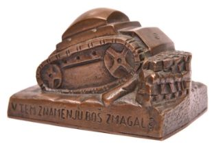 A heavy hand finished cast bronze desk paperweight, in the form of a tank surmounting an obstacle,