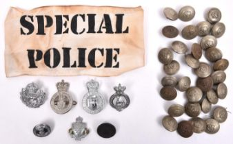 33 Nottinghamshire Constabulary KC large WM tunic buttons; 4 police cap badges and 4 other items. GC