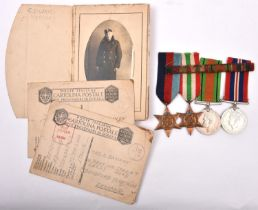 Four: 1939-45 star, Italy star, Defence, War (un-named as issued), VF, together with a pack of