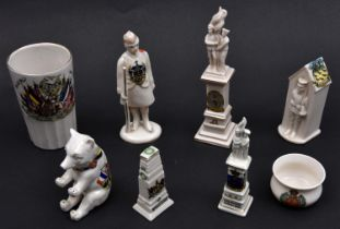 8 very good crested china items, comprising: War Memorial surmounted by Tommies (Matlock); a similar