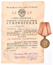 A WWII Soviet Russian medal for the Defence of Stalingrad, first type issued during the war, with