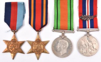 Four: 1939-45 star, Burma star, Defence, War medal with MID emblem (un-named as issued) with
