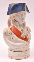 """An old glazed earthenware """"character"""" jug in the form of Admiral Nelson, wearing medals and"""