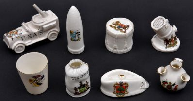 8 Crested China Items comprising R.N.A.S. Anti Aircraft Lorry (Birmingham), Artillery Shell (