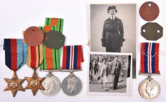 A husband and wife WWII group comprising: Four: 1939-45 Star, Africa star, Defence, War medals (un-