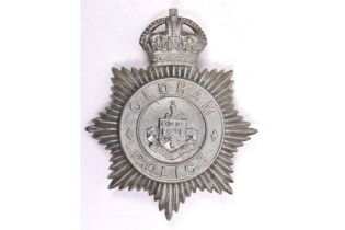 A pre 1952 Oldham Police helmet plate, white metal with traces of chrome plating. GC £20-40