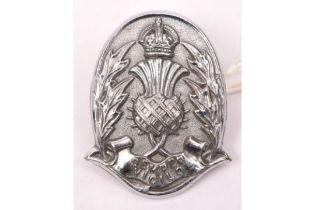 A rare pre 1952 Edinburgh City Police cap badge size chrome plated helmet plate. GC £30-50