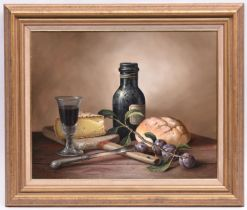 Brian Davies (1942 - 2014), oil painting on canvas. A still life with wine, bread and cheese. Signed