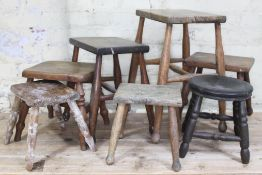 A group of seven wooden stools, heights ranging from 24.5cm to 53.5cm.