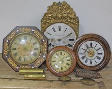 A group of four continental wall clocks.