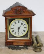 A continental 19th century wag on the wall cuckoo clock, height 30.5cm, with brass cased weights and
