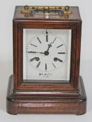 A French late 19th century marquetry inlaid rosewood mantel clock, gilt metal handle and bevelled