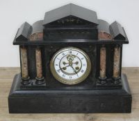 A Victorian black slate and marble mantel clock with visible brocot escapement, length 37cm.