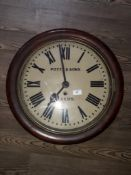 """A late Victorian oak wall clock, the 16"""" dial painted with Roman numerals and signed Potts & Sons"""