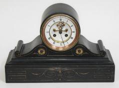 A Victorian black slate mantle clock with visible brocot escapement, length 35cm.