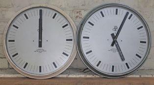 A pair of International Time Recording Co LTD round wall clocks, total diam. 50cm each.
