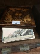 An inlaid box with collection of postcards Live bidding available via our website, if you require