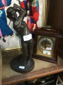 A bronzed golfing figure and a mantle clock Live bidding available via our website, if you require