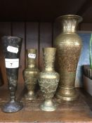 A quantity of eastern brass vases Live bidding available via our website, if you require P&P