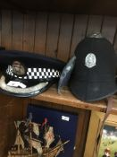Two vintage police hats Live bidding available via our website, if you require P&P please read