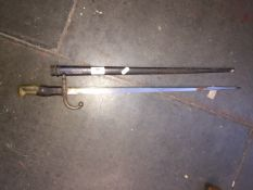An antique French bayonet and scabbard Live bidding available via our website, if you require P&P