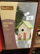 A bird nesting box Live bidding available via our website, if you require P&P please read