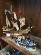 A model galleon and fishing boat Live bidding available via our website, if you require P&P please