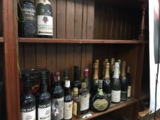 A quantity of mixed alcoholic drinks including wines, champagne, whisky, rum and a bottle of Chateau