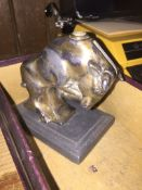 A cast metal bull match striker on plinth Live bidding available via our website, if you require P&P