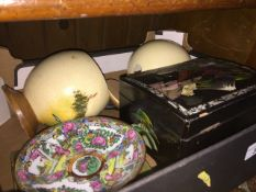 A box containing Ostrich eggs and Oriental items Live bidding available via our website, if you