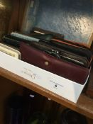 A box with quantity of leather purses, wallets, miniature bibles and prayer books, etc. Live bidding