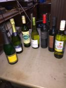 Seven bottles of wine including Buck's Fizz and Champagne