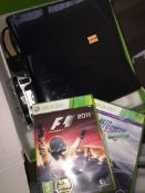 An Xbox 360 console with accessories to include controller and 2 games.