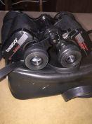 A set of Tasco binoculars in case.