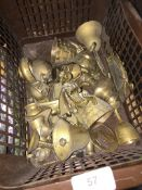 A box of brass ornaments, etc.
