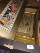 A box of Oriental textile pictures