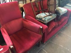 An early 20th century settee with red upholstery together with an armchair