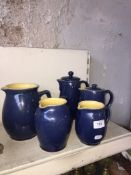 Five blue Denby jugs