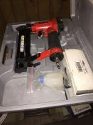A pneumatic nailer and a soldering kit - both cased.