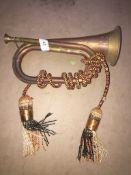 A brass and copper bugle