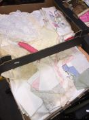 Two boxes of linen and textiles