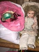 A 1920's Armand Marseille bisque doll and a bag with small dolls, accessories and few ladies
