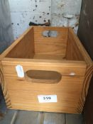 A small wooden APPLE box.