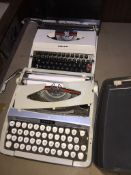 2 vintage typewriters.