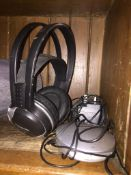 A set of Panasonic cordless headphones RP WF910H with docking station and charging cable