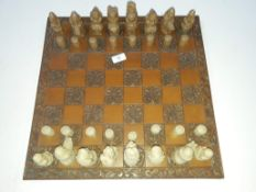 Chess board and chess pieces.